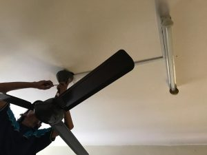 ceiling fan installation in progress