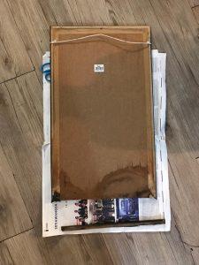 toilet mirror - broken frame at bottom due to water
