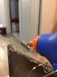 toilet mirror - hot glue frame